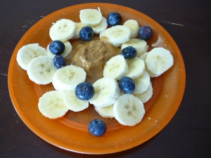 Sliced bananas with blueberries